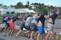 fence surfing at Maho beach St Maarten