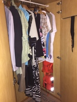 8350 - Closet with our clothes. Storage shelves to left of opening