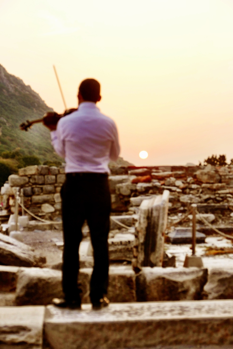 Azamara ~ Evening Ephesus...  A musician practicing before the concert.