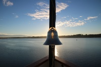 SS Legacy's bell on the bow at sunrise on the Columbia River