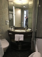 Cabin 8063, view of bathroom with lovely tile, large sink and lighted mirro