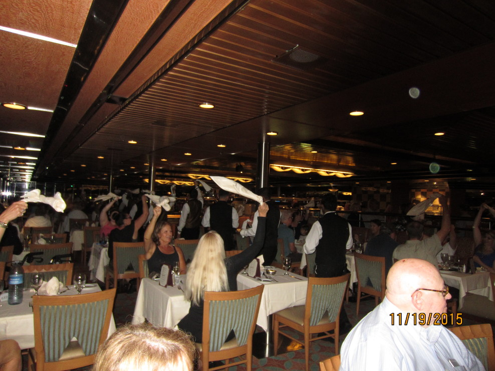 Guests waving napkins as Wind Star restaurant staff entertain guests