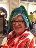 Great Grandma at dinner after the wait staff gave everyone handmade hats.
