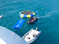 Floats behind watersports platform