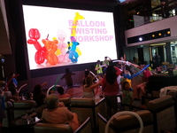 Atrium balloon activity, c/w mega large LED screen.