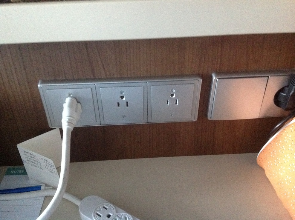 110 v outlets at the desk.  NCL Escape mini