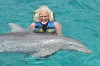 Mom swimming with the dolphins in Cozumel, Mexico at Chankanaab Adventure B