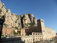 Montserrat Abbey built on the side of a mountain.