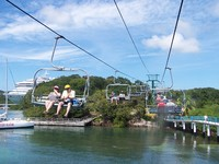 On the ski lift chairs to the Carnival beach at Roatan