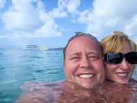 A ocean swimming selfie with our ship in the background.