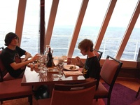 Dining in the Blush restaurant upper deck near windows.