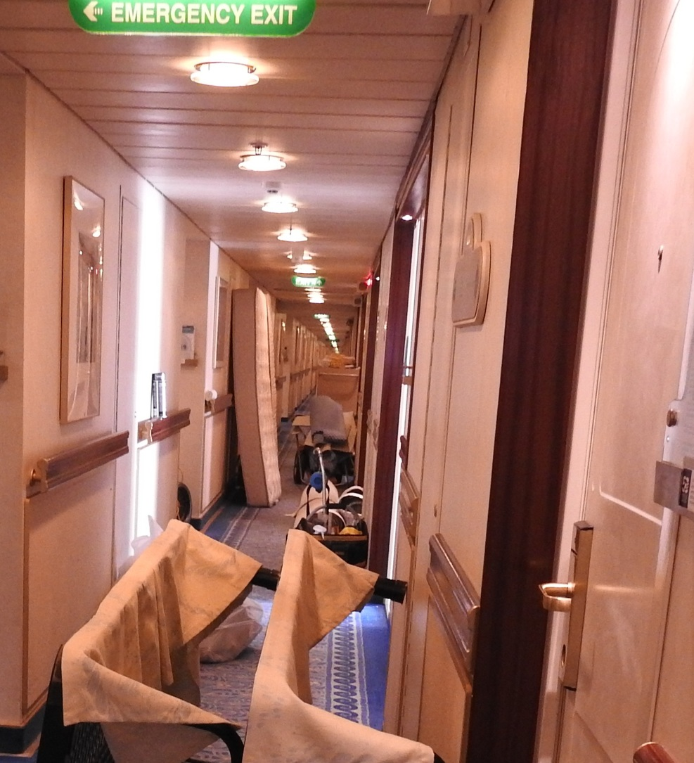 This cabin has its furniture and bedding stacked in the corridor