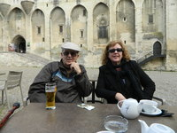 Bob Willett and Daughter sip in front of the Papal Palace in Avignon where Popes ruled for about 40 years, leaving Rome