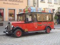 Vehicle in front of Christmas shop in Rothenburg.