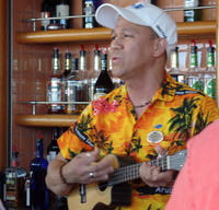 Talented Bartender serenading lucky passengers at the aft pool