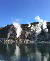 Steam and Geysers on Lake RotoMahane in the Waimangu Valley