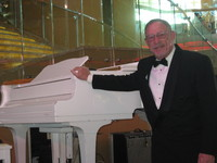 Fooling with the piano on formal night before the band came on.