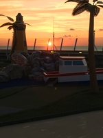 sunset over the putt-putt course