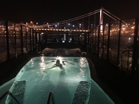 Watching the illumination cruise in Budapest from the heated rooftop pool