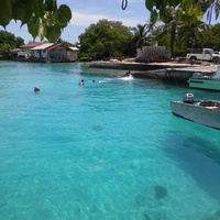 I shot this photo at a small port on the north side of Rangiroa. The photo was of children playing off the dock but the boat appear to be levitating!   The water is THAT clear!