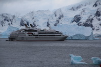Le Lyrial standing offshore from Portal Point while passengers visited the seals and penguins on the Antarctic mainland.