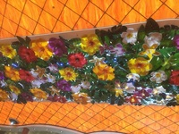 Plastic flowers on the ceilingi