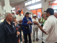 The chef in the market at Cannes trying to explain something important to us