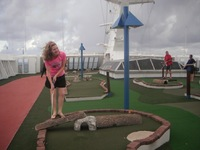 Playing mini golf on the roof.