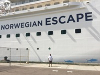 The NCL Escape cruise ship.  My husband in the foreground.