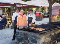This is Dave and Juan smoking salmon in Juneau during our gold panning and salmon bake excursion.