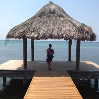 Standing on the dock at Spa Baan Suerte in Roatan after my facial, body scrub