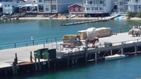 Mackinac Island dock view from room.  Horse drawn hay wagon.