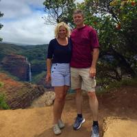 Here are the honeymooners in Kaui. Just look at that waterfall in the canyo