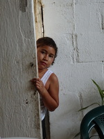 Peeping at the strangers, Little girl in Mexico.