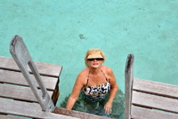 Here i am climbing down the ladder from our bungalow into the warm shallow lagoon
