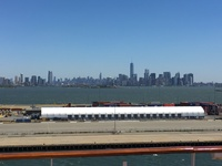 The Manhattan skyline with the Statue of Liberty off the port side while do