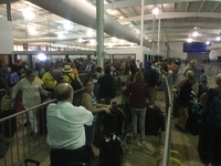 Long hour plus line in the heat in terminal to go home.