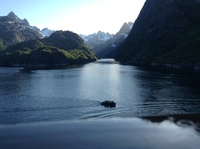 Sailing carefully into the narrow Troll Fjord.
