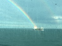 Pot of gold landing on this oil tanker (as you can see, windows from dining room)