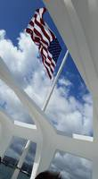 Flag at half staff through the USS Arizona Memorial roof