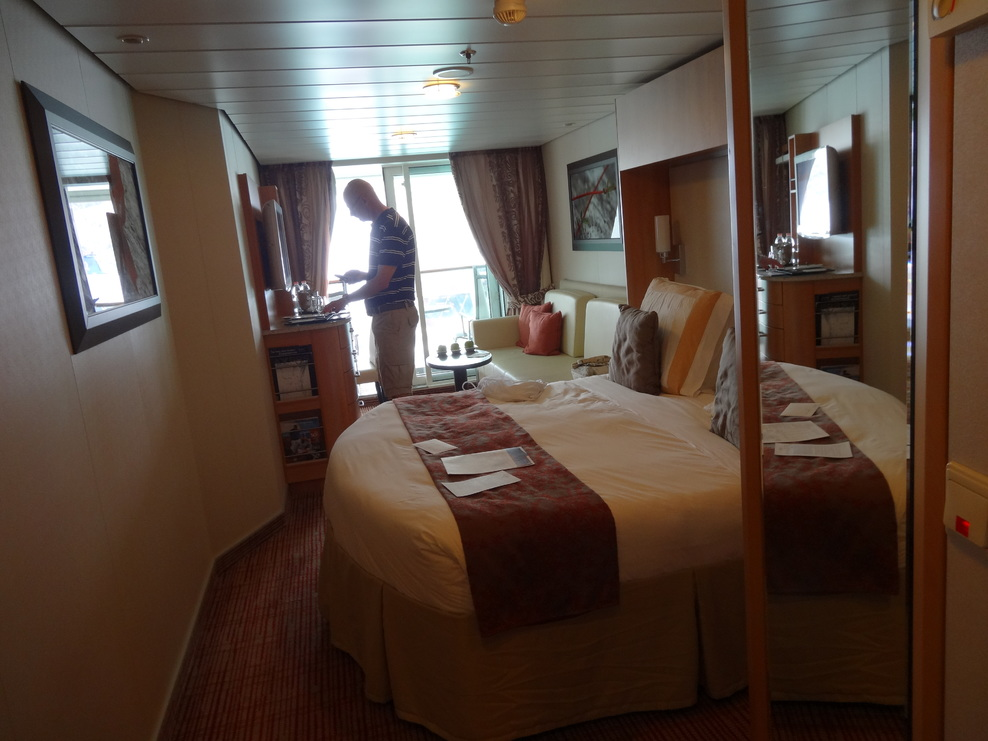 Celebrity Equinox Cabin #1584 view from doorway to veranda sliding doors. P
