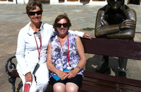 Sisters on tour. Sitting with the waiting soldier in Bratislava square.