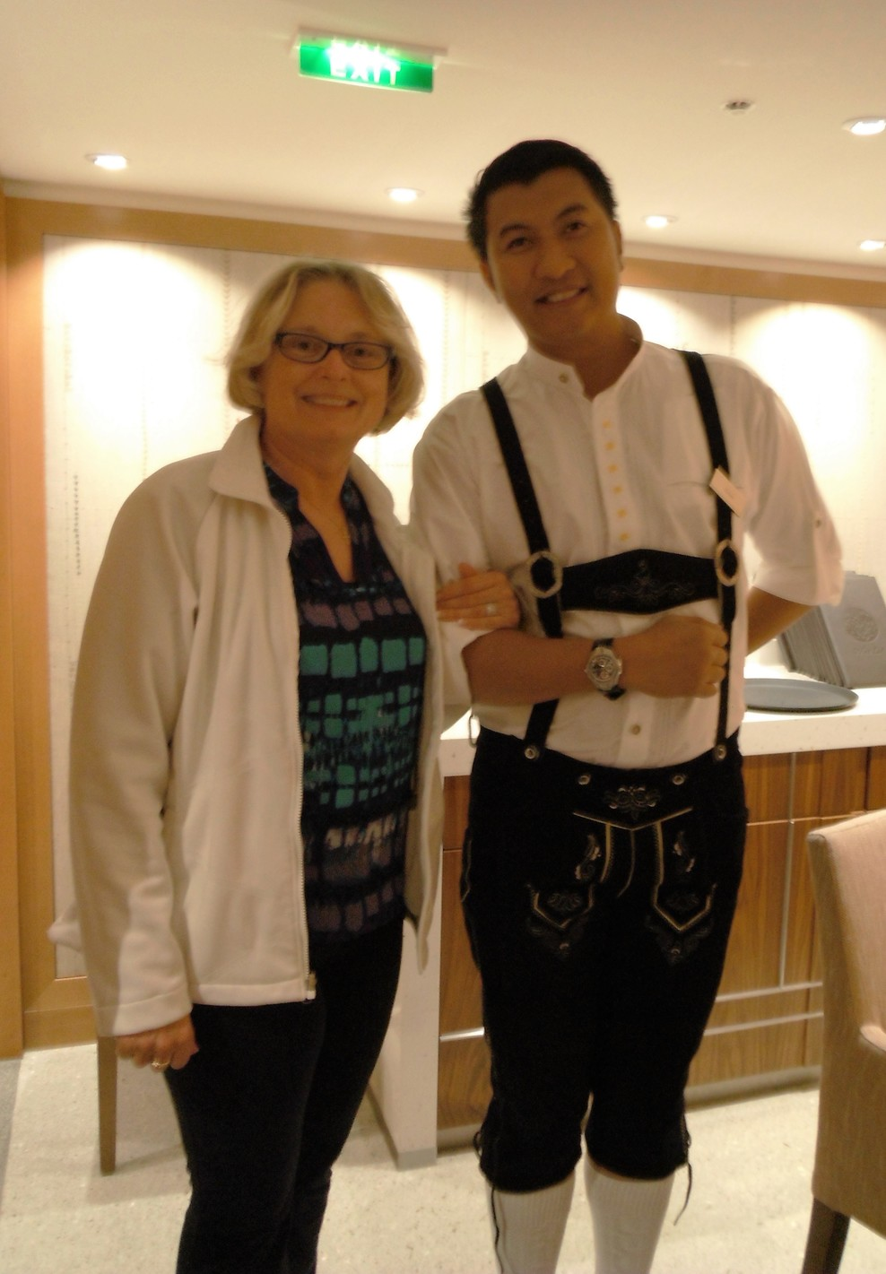 "Nancy and our waiter, Elmer (in lederhosen) during our ""Taste of Austri"