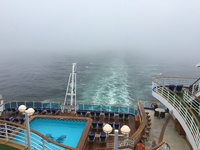 View out the back of ship into the fog.