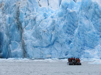 Riding a zodiac boat up to a glacier in Glacier Bay