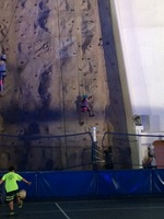 family on rock wall