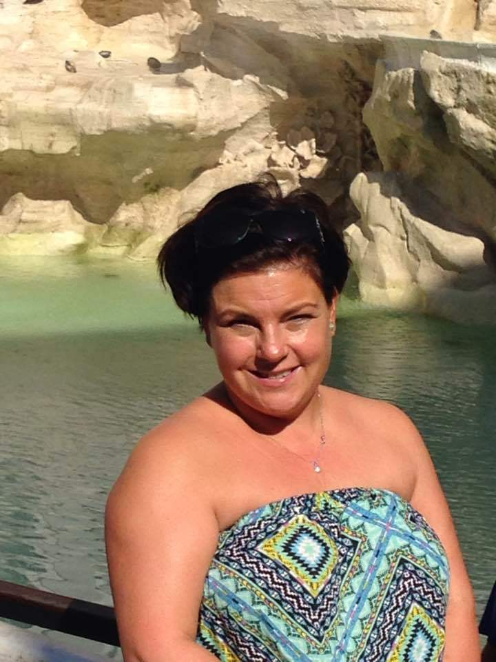 A photo of me at the Trevi Fountain in Rome