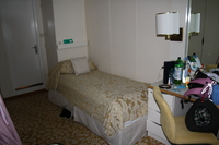 Cabin (daywear on bed)from the window bed, there is a table and chair to th