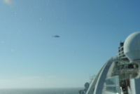 the Irish Coast Guard helicopter surveying our ship while we were broken down