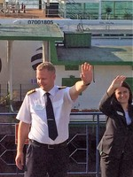 waving goodbye to captain and hotel manager